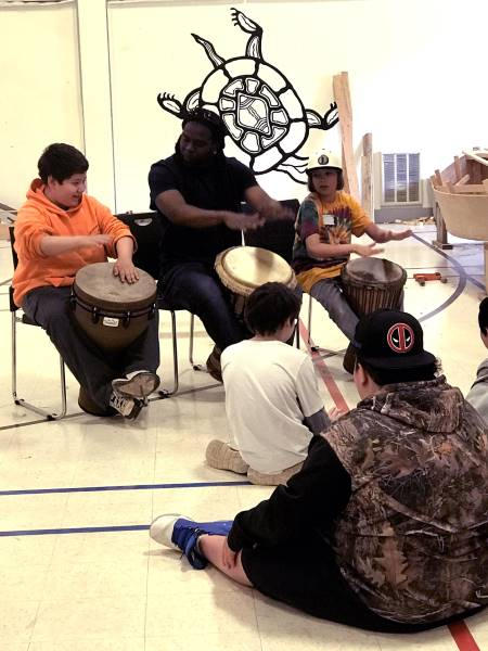 Boat building school students at Pictou Landing First Nation get some drumming instruction