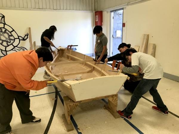 Students at Pictou Landing First Nation put finishing touches on a new boat