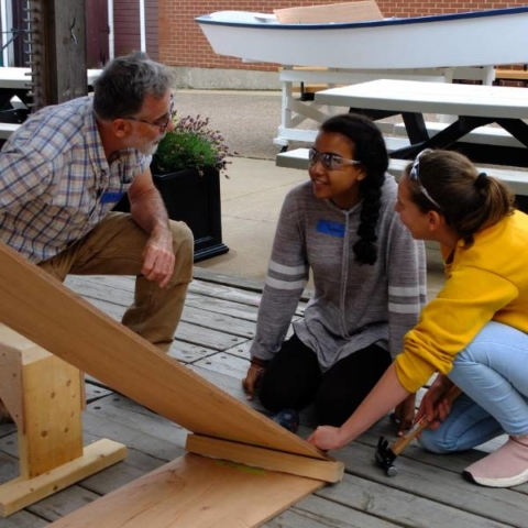 Boat school students learn from the expert